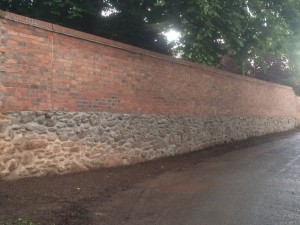 Re-built boundary wall on manor house